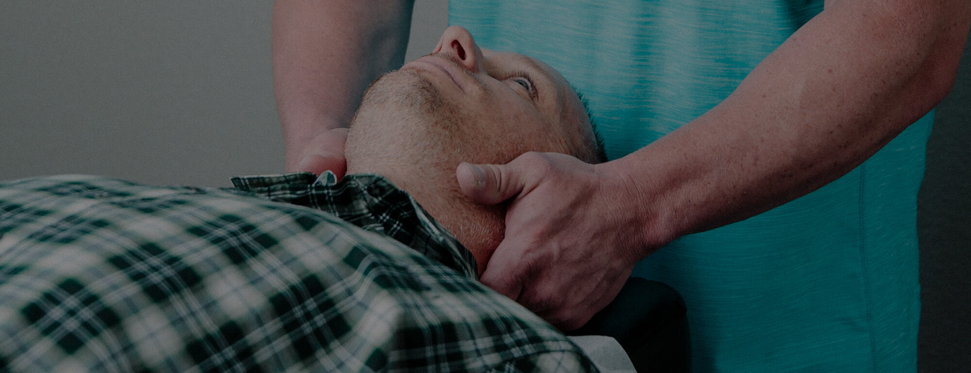 Dr. Day performing a neck adjustment for a personal injury chiropractor patient.