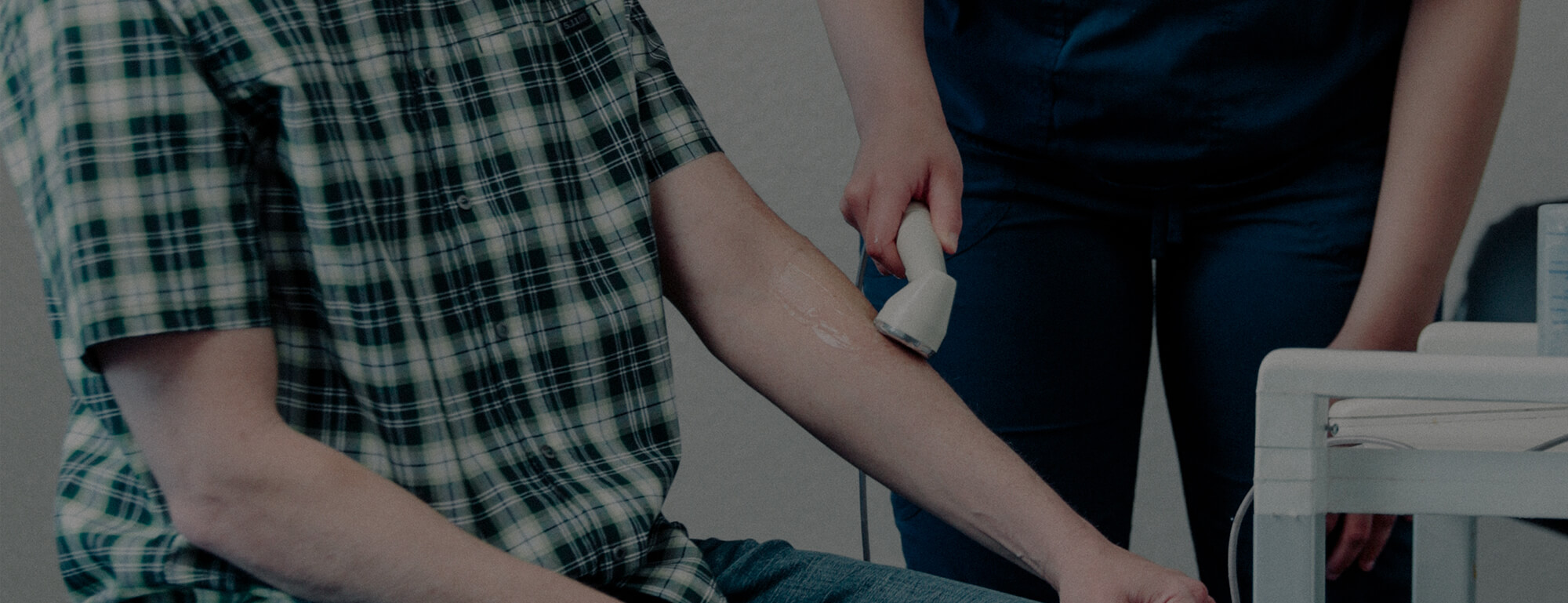 A Day Chiropractic staff member performs therapeutic ultrasound on a make patient.